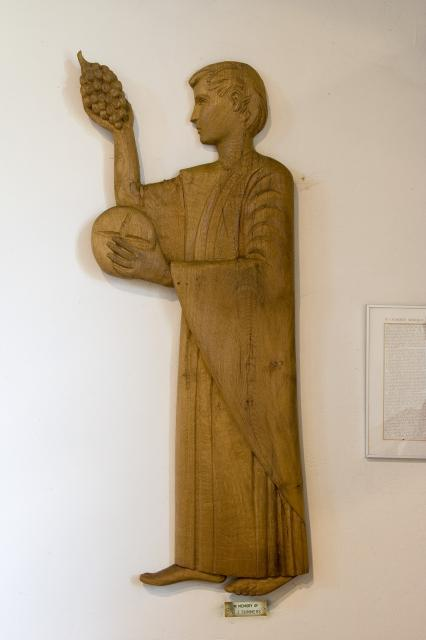 Figure Holding Bread and Grapes