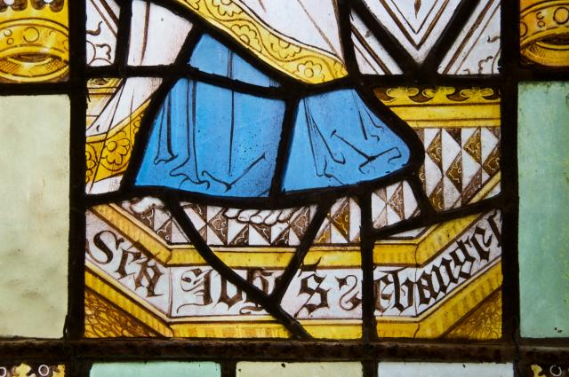 Inscription beneath St John the Evangelist    detail from    The Crucifixion with the Virgin Mary and St John